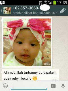 anak bayi memakai turban barbie dari kembarshop - toko baju bayi murah